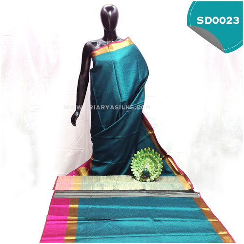 Peacock Green kora organza with one side tissue border and other side pink chakra border