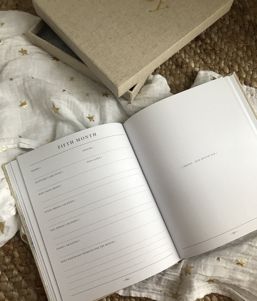 First year baby journal for recording memories and milestones, month by month