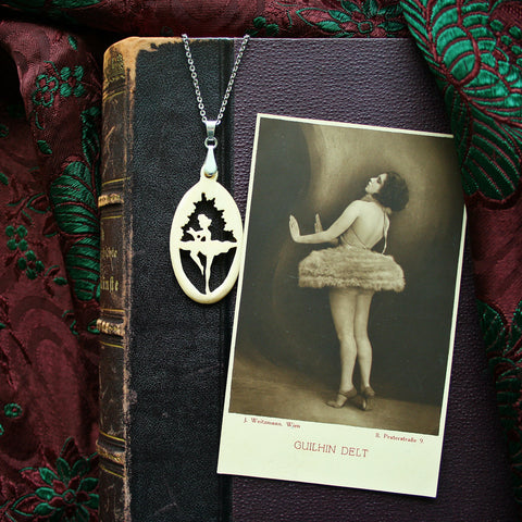 """Ballerina""- Carved bone fairytale pendant. Handmade and antique."