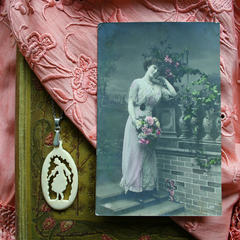 """Edwardian Lady""- Carved bone fairytale pendant. Handmade and antique."