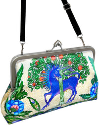 Unicorn and dragon printed satin clutch bag based on William de Morgan tiles. By Baba Studio