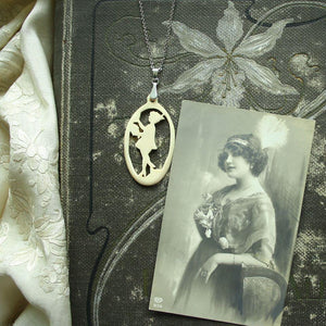"""Lady with Flowers"" - Carved bone fairytale pendant. Handmade and antique."