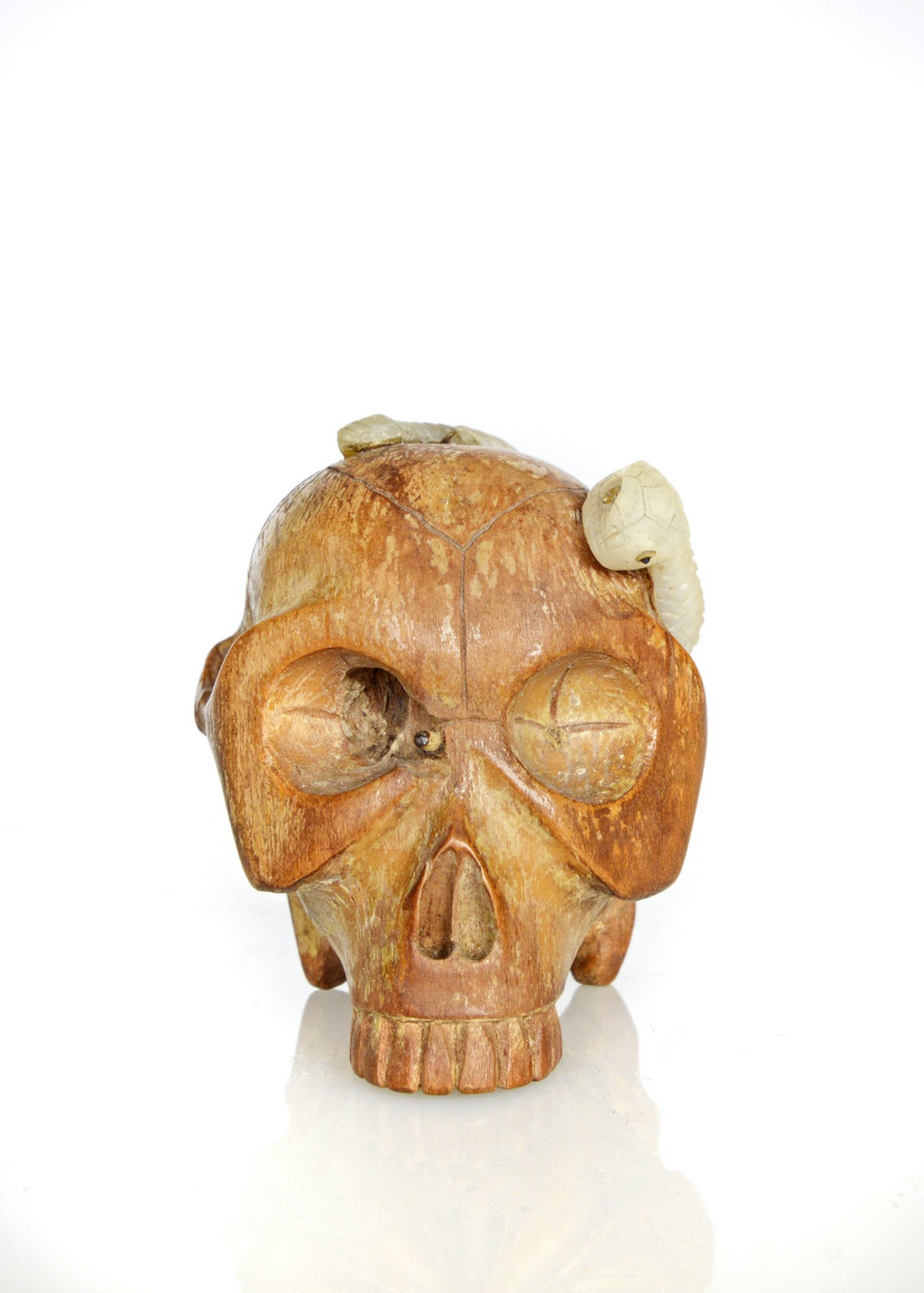 Carved skull with mother of pearl grave worms