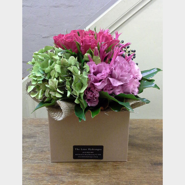 Grouped seasonal blooms in a box