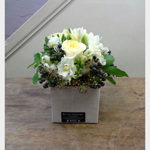 Seasonal posy in a box