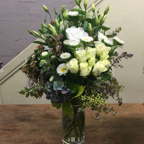 Seasonal white and green bouquet in a vase