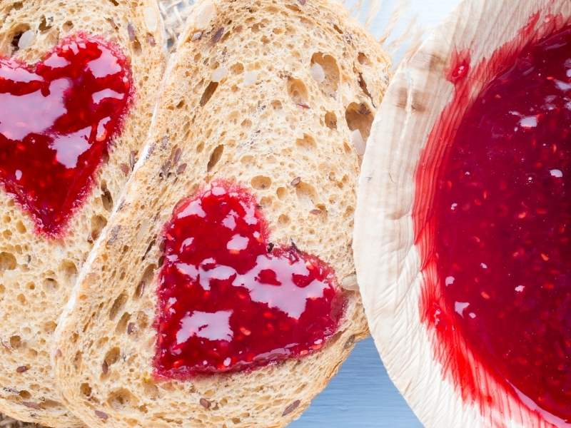 Heart-shaped jam spread on bread
