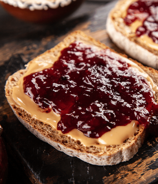 Jam on a peanut butter and jelly sandwich