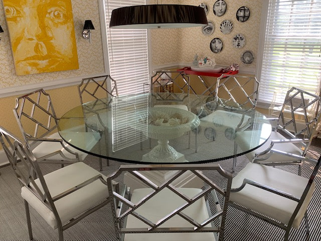 Round Glass Dining Room Table on an antique garden urn