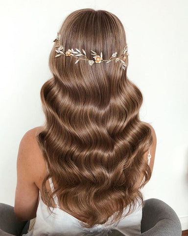 vintage curls hairstyle for long hair asian bridal