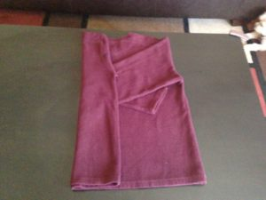 4. Fold over one side of the sweater to the middle