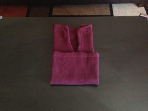 6. Fold the sweater up once or twice, depending on the length of the sweater