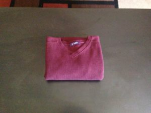 7. Flip the sweater over and place it neatly in your dresser