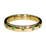 tsavorite-yellow-gold-eternity-ring