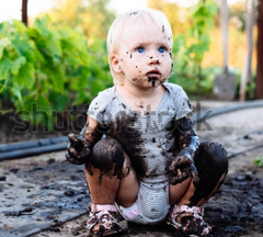 Muddy childrens clothes
