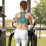 Back view of a pretty woman in a gym wearing a Sports bras printed with Exotic birds tropical pattern