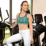 Front view of a pretty woman in a gym wearing a Sports bras printed with Exotic birds tropical pattern