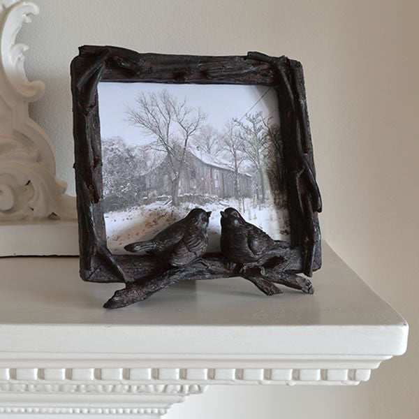 Picture frame with birds in brass