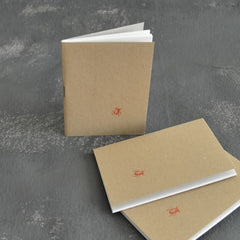 3 mini notebooks with letterpress beetle motif