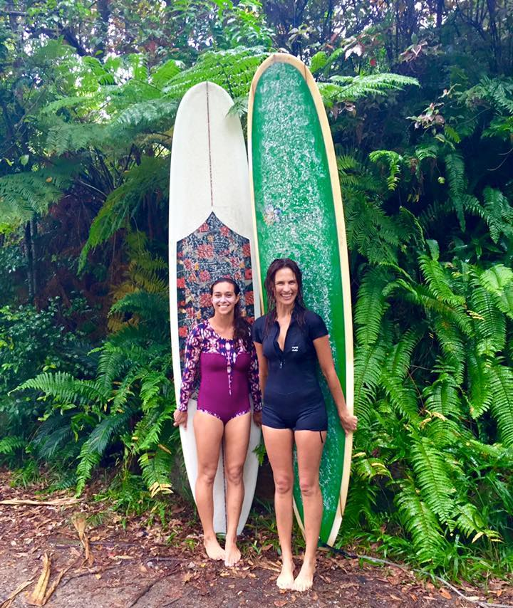 Isabelle Braly and friend women surfers with surfboards
