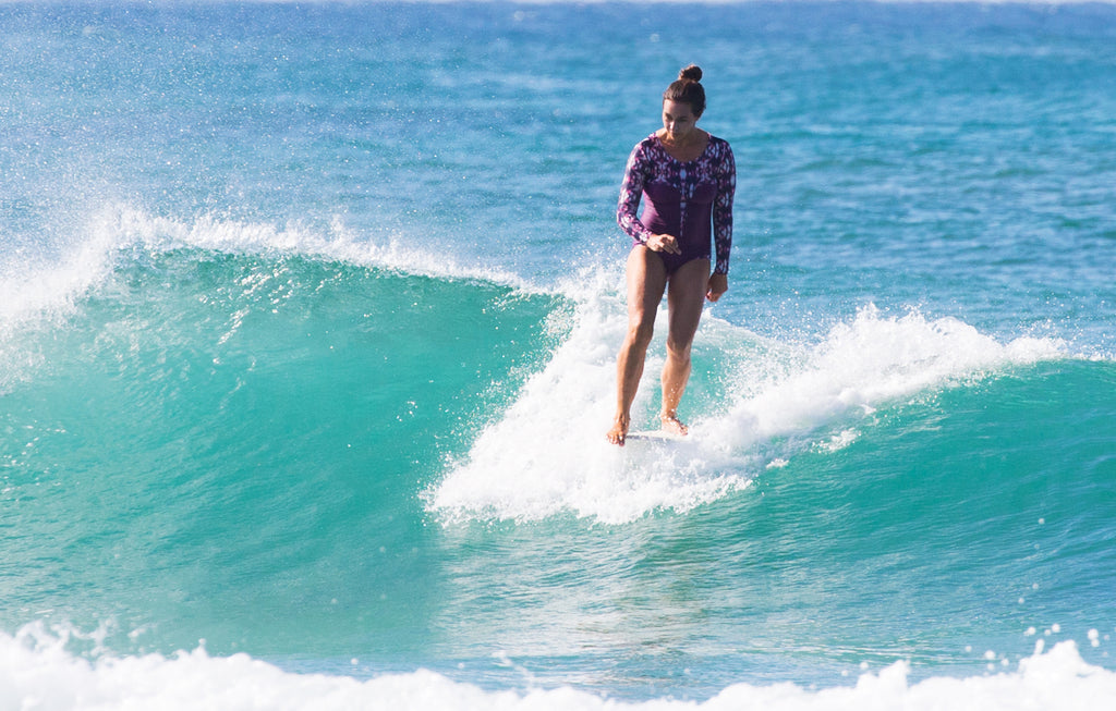 Surfer in the Lafitenia surfsuit mauve pink Lore of the Sea