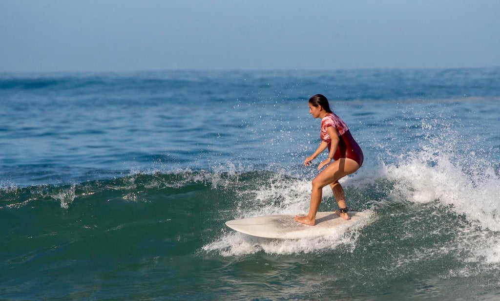 woman surfing pregnant