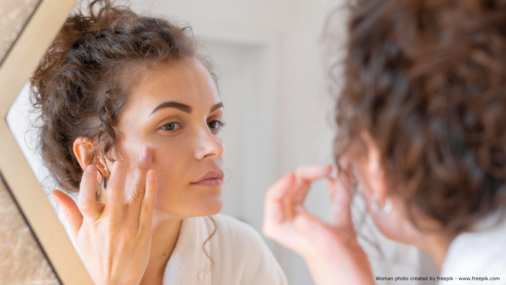 Woman determining the skin type in the mirror