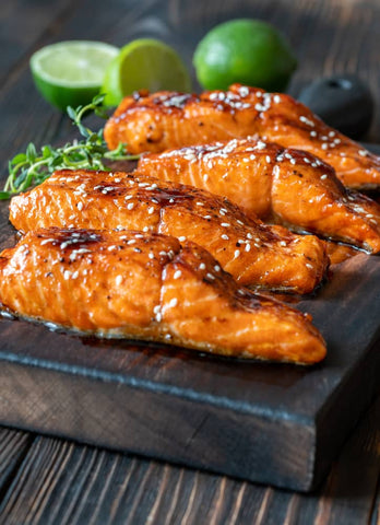 Salmon served with sticky honey and soy glaze, topped with sesame seeds