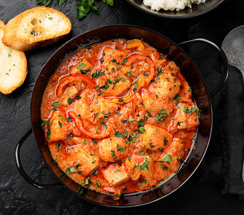 fish stew with tomatoes in a pan