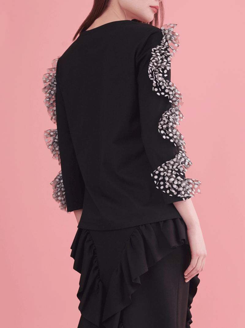 chic black jersey top with swirly dotted ruffles on sleeves