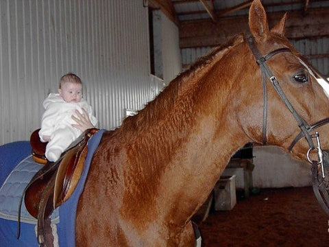 Samantha King's daughter Katie on the schoolhorse Boomer - Red Scarf Equestrian