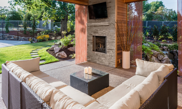 a rustic style patio overlooking a sunny garden