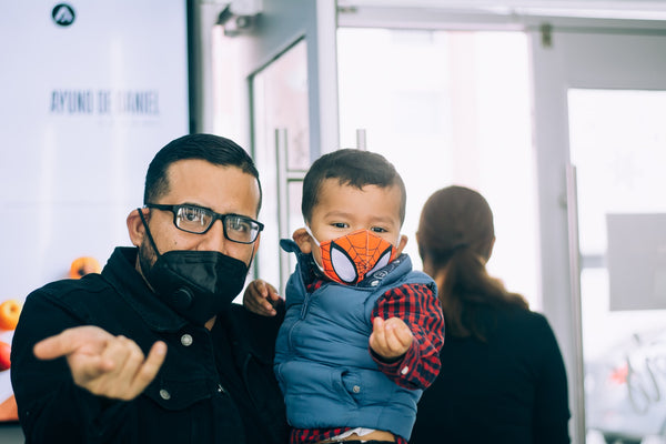 father and toddler son wearing cloth face masks