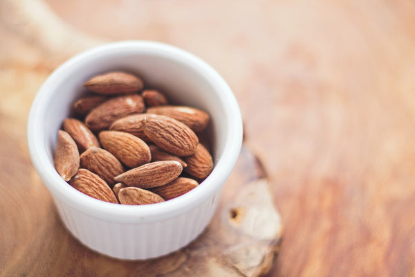 small white bowl with almonds