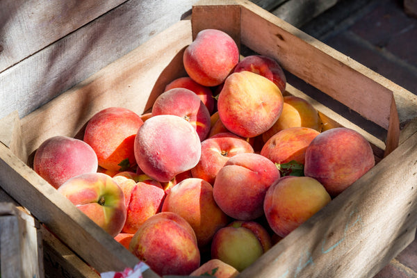 a crate of juicy peaches