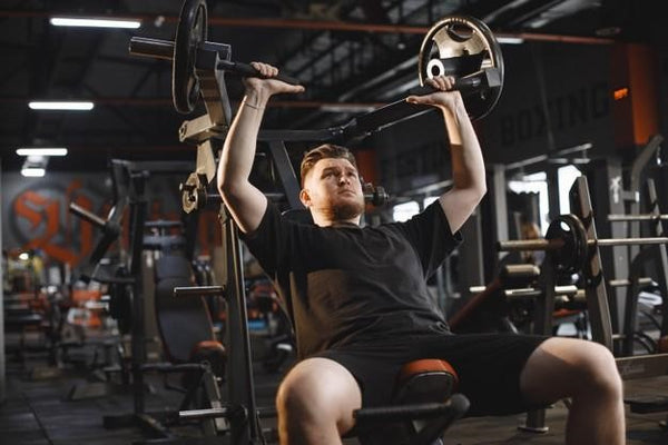 man in black shirt and shorts working out at the gym