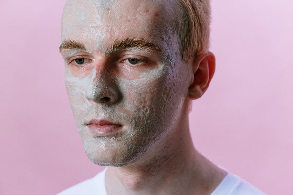 man's face with moisturizing mask on face