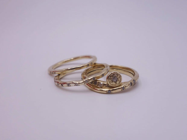 Intertwined Gold Rings with Diamonds