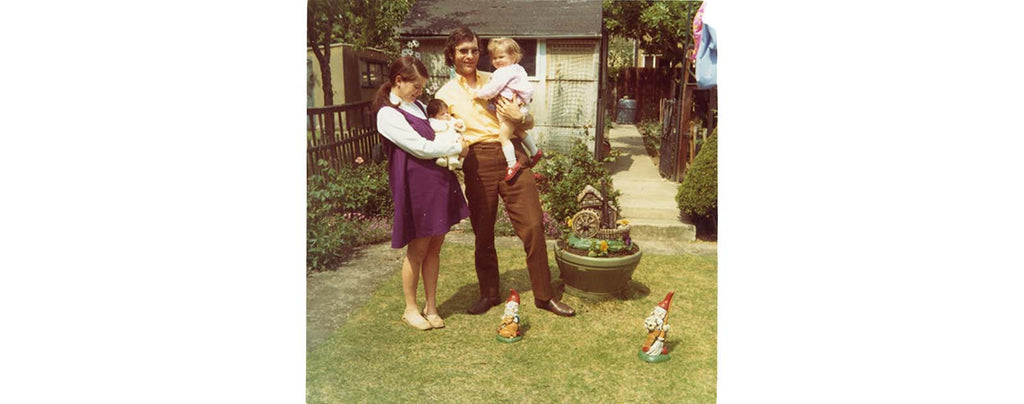 Happy Family With Garden Gnomes On Grass