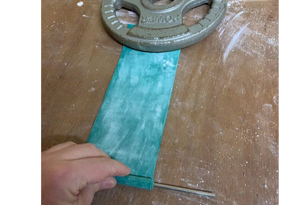 using weight to wrap steel