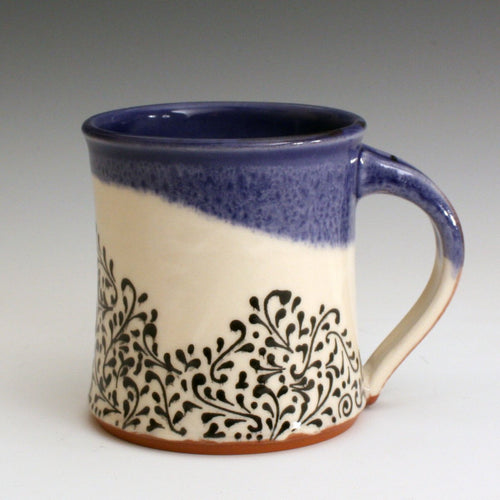 Blue and white hand made mug with hand decorated fine line black decoration.  Handmade with red earthenware clay and food safe glazes.