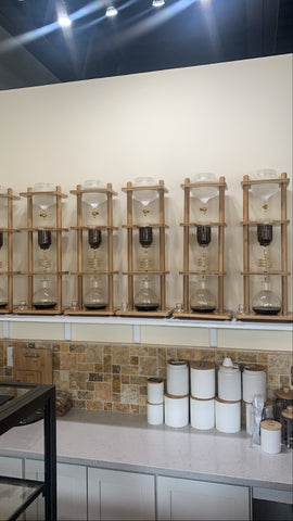 a row of yama cold drip towers in a coffee shop