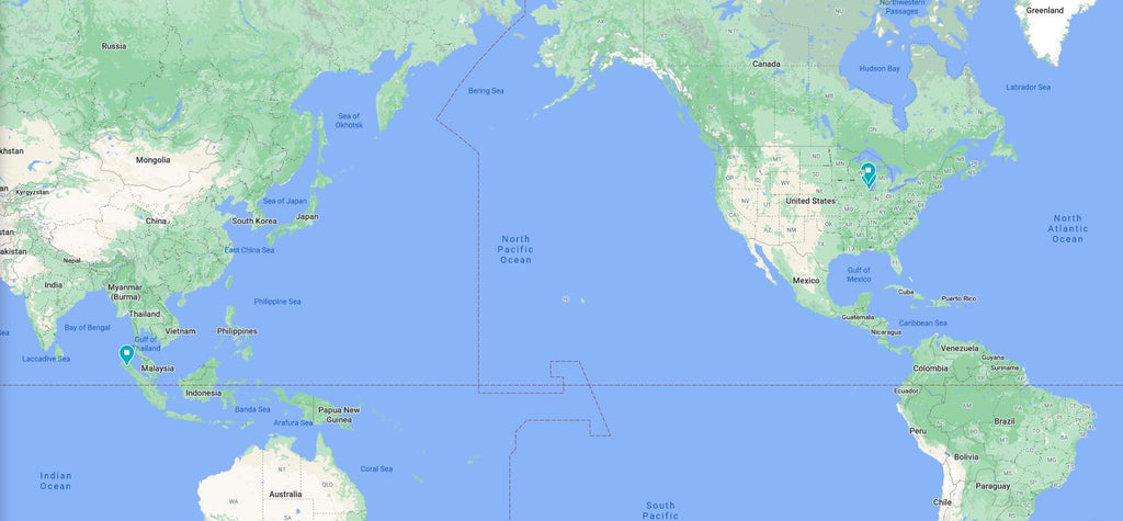 A map of the world, with pins in Sumatra Indonesia, Milwaukee USA and Chicago USA.