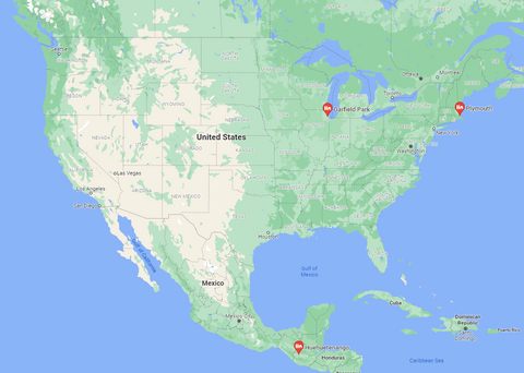 a map with a pin in guatemala, and two pins in the usa. one in massachusetts and one in chicago.