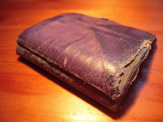 old tattered wallet