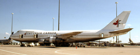 While waiting for a flight at Mirabel on July 29, 1994, I spotted 747-200 C-FXCE on the ramp in the colours of Fortunair