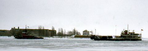 The Wolfe Islander in a distant shot from February 15, 1975 under tow by the tug Salvage Monarch