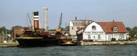 The Pike's Salvage dock on the Kingston waterfront on July 31, 1975 showing the work vessel Mapleheath and tug Daniel McAllister