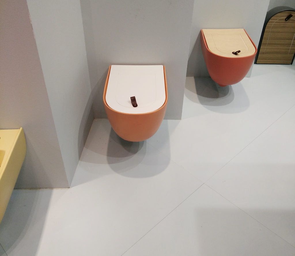 Wall hung toilets in natural, earthy tones