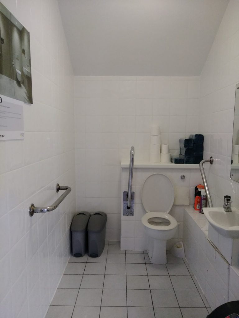 Before: a clinical wheelchair accessible toilet
